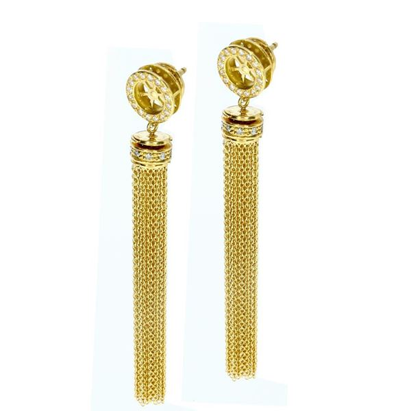 Picture of 18k yellow gold earrings with wheel element design and diamond studded pompons